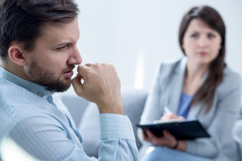 Photo of female psychiatrist diagnosing her male patient